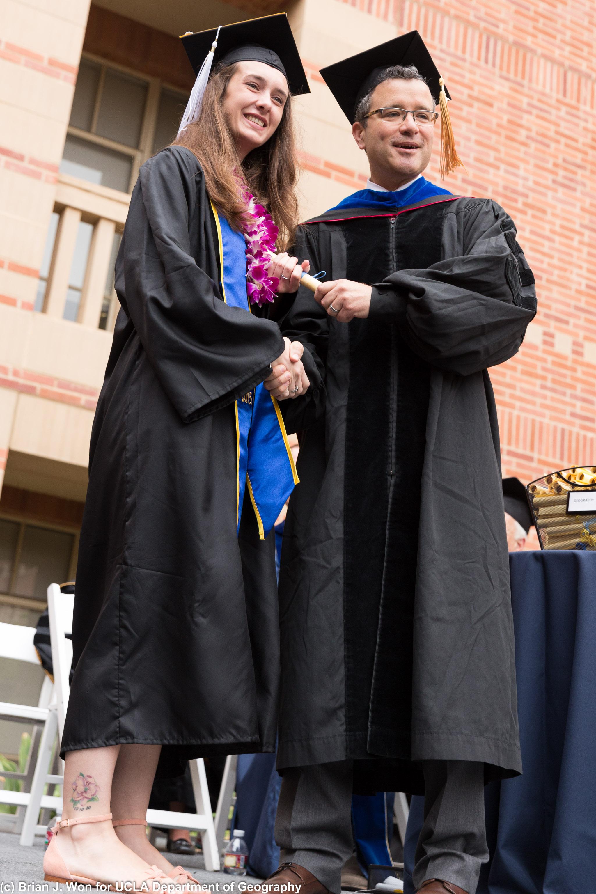 Undergraduates walking on stage