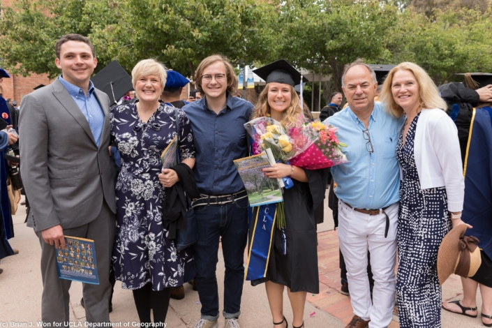 Photo of newly graduated students with family and friends
